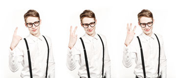 Young man shows one two three fingers tripple photo Royalty Free Stock Image