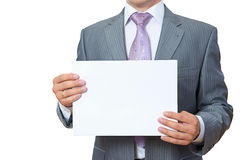Young man shows paper Stock Images