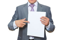 Young man shows paper Stock Photo