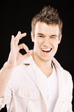 Young man shows sign OK Royalty Free Stock Photo