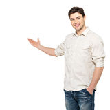 Young man shows  something isolated on white Royalty Free Stock Photo