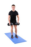 Young man shows starting position of dumbbell Stock Photography