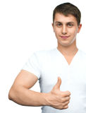 Young man shows thumb up gesture Royalty Free Stock Images