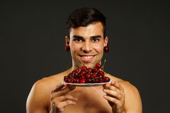 Young Man Shows You Red Fresh Cherry Stock Image