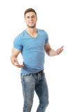 Young man shrugging his hands. Stock Photo