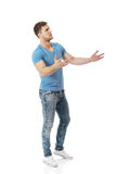 Young man shrugging his hands. Handsome young man shrugging his hands royalty free stock photo