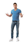 Young man shrugging his hands. Stock Images