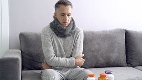Young man sick and freezing at home.  stock footage
