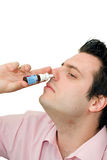 Young man sick, putting nose drops Stock Images