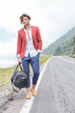 Young man on the side of the road Stock Image