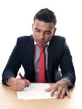 Young man signing contract Stock Photo