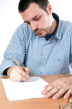 Young man signing contracts Royalty Free Stock Photo