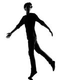 Young man silhouette Stock Photography