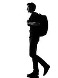 Young man silhouette backpacker walking Stock Photography