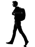 Young man silhouette backpacker walking Stock Photos