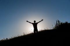 Young man silhouette joy Stock Photo
