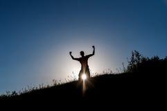 Young man silhouette joy Stock Photos