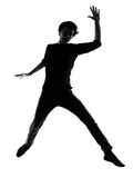 Young man silhouette jumping happy Stock Photography