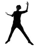 Young man silhouette jumping happy Royalty Free Stock Image