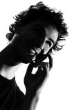 Young man silhouette telephone Stock Photo