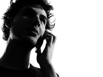Young man silhouette telephone Stock Images