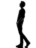 Young man silhouette walking  happy laughing Royalty Free Stock Photography