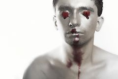 Young man with silver make-up Royalty Free Stock Image