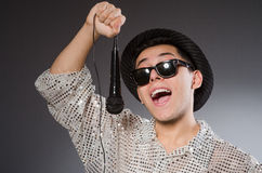 Young man in silver shirt and microphone isolated Royalty Free Stock Photos