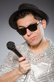 Young man in silver shirt and microphone isolated Royalty Free Stock Photo