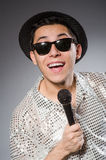 Young man in silver shirt and microphone isolated Stock Photography