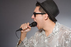 Young man in silver shirt and microphone isolated Stock Photo