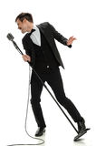 Young Man Singing inot Vintage Microphone Royalty Free Stock Photos