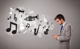 Young man singing and listening to music Royalty Free Stock Photos
