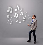 Young man singing and listening to music Royalty Free Stock Photo