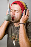 Young man singing in microphone Royalty Free Stock Image