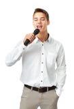 Young man singing Royalty Free Stock Photos