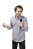 Young man is singing with microphone Royalty Free Stock Image