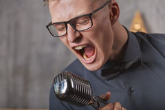 Young man singing with microphone Royalty Free Stock Photo