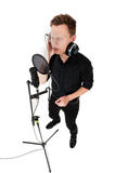Young man singing song. In studio on white background royalty free stock photos