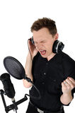 Young man singing song. With passion in studio stock photography