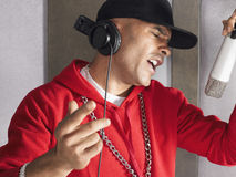 Young Man Singing In Studio Royalty Free Stock Image