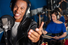 Young man singing in studio royalty free stock photos