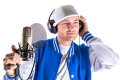 Young man singing in the studio Stock Photography