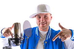 Young man singing in the studio Royalty Free Stock Image