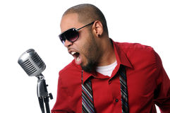 Young Man Singing Into Vintage Microphone Royalty Free Stock Images