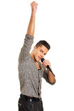 Young man sings Royalty Free Stock Photo