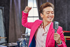 Young man sings into microphone Royalty Free Stock Photo