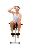 Young man sit on bench for fitness and rest Royalty Free Stock Image