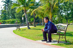 Young man sit on the bench stock photo