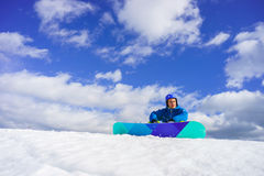 Young man sit on the snow Royalty Free Stock Photography